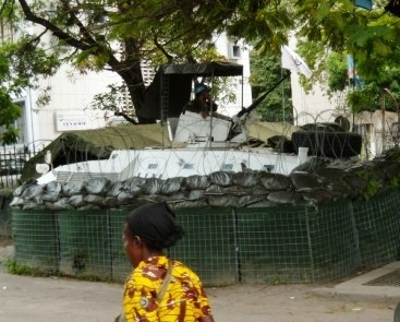 Guard in APC with machine gun outside MONUC headquarters